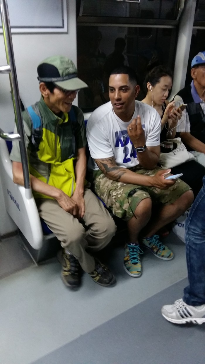 On the train on the way to Suwan, my assistant struck up a conversation with an old Korean.