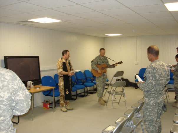 Thanksgiving service at COB Basrah. This is my assistant, SGT Miles leading one of the songs.