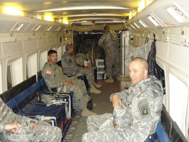 Inside the C-23 Sherpa (my assistant is on the left).