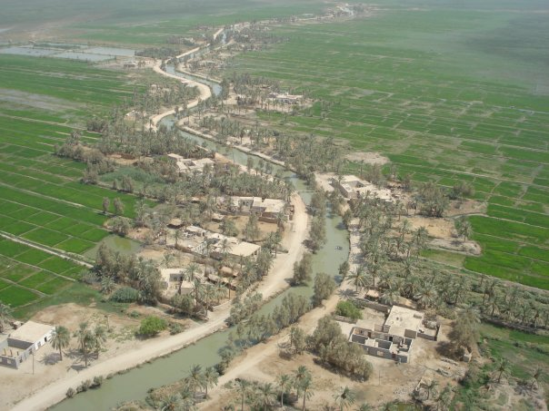 View of a village built up around a irrigation ditch.
