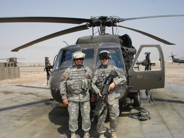 Me & my assistant preparing to fly on the Blackhawk.