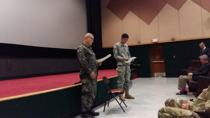 MAJ Kim, ROKA (left), introducing MG Ryu with MAJ Kim's KATUSA/Interpreter (right).