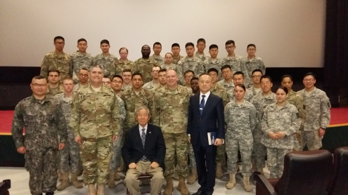 A group of Soldiers and KATUSAs from the BDE with MG Ryu (seated), the INSCOM Chaplain (left of MG Ryu) and me (right of MG Ryu). The interpreter is in a suit to my left.