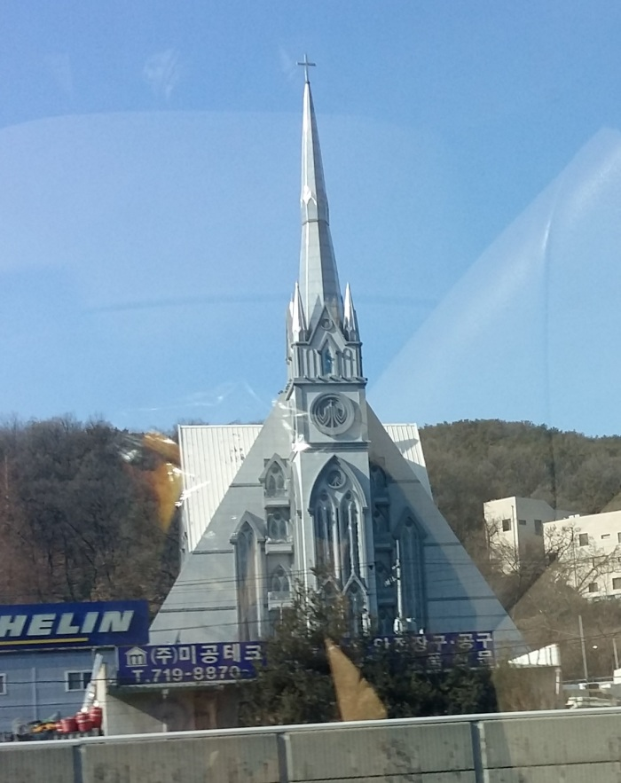 A large modern-Gothic church beside I-1 just inside the Seoul toll gate